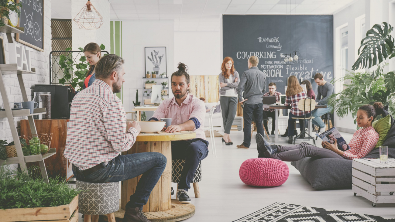 Marketing agency workers having coffee break at comfortable relax zone